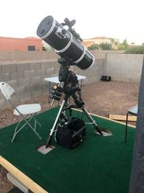 A picture containing object, outdoor, telescope, chair  Description automatically generated
