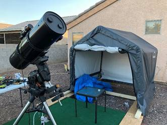 A picture containing object, outdoor, telescope, building  Description automatically generated