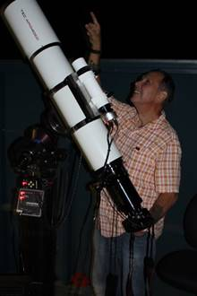 A picture containing person, indoor, telescope  Description automatically generated