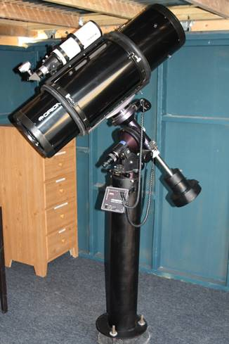 A picture containing floor, indoor, telescope, black  Description automatically generated